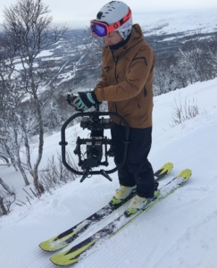 Skiing with a red camera